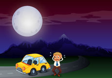 A boy with his car in flat tires Royalty Free Stock Image