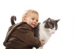 Boy and his cat. Twenty month old boy hugging his cat Stock Photo
