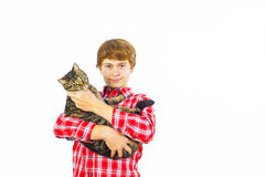 Boy with his cat in the arm. Happy boy with his cat in the arm Royalty Free Stock Photos