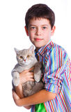 Boy with his cat. Cute boy with his cat smiling at camera on isolated white background Stock Photography
