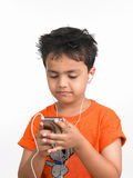 Boy with his cell phone Stock Photo