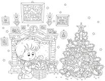 Boy with his Christmas gift. Black and white vector illustration of a little boy sitting with his holiday gift near a fireplace and a colorfully decorated Royalty Free Stock Images