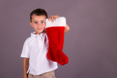 Boy and his Christmas stocking Stock Photos