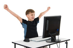 Boy on His Computer. Boy on computer with cordless mouse and keyboard royalty free stock image