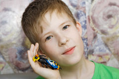 A boy with his craft. A clay hornet in focus Royalty Free Stock Photos