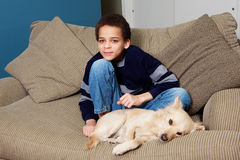 Boy and his dog Royalty Free Stock Image