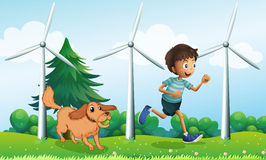 A boy and his dog near the three windmills Royalty Free Stock Photos