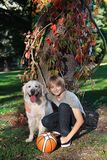 Boy with his dog in the park Royalty Free Stock Photos