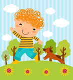 A boy and his dog playing in the park Stock Images