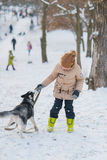 Boy with his dog in the snow Royalty Free Stock Photo
