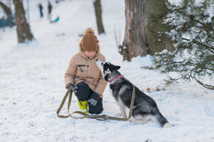 Boy with his dog in the snow Stock Image