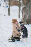 Boy with his dog in the snow Stock Photos