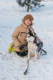 Boy with his dog in the snow Stock Images