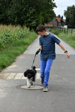 Boy and his dog Stock Images