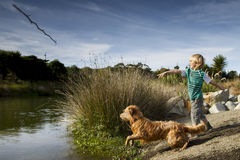 Boy and his dog. Young boy playing outside with his dog Royalty Free Stock Photos