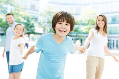 Boy with his family in the background Royalty Free Stock Image