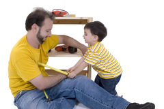 Boy And His Father Building A Storage Cabinet Together royalty free stock photos