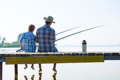 Boy and his father fishing togethe Stock Photo