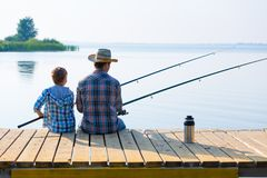Boy and his father fishing togethe Royalty Free Stock Images