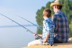 Boy and his father fishing togethe Stock Photography