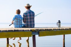 Boy and his father fishing togethe Royalty Free Stock Photo