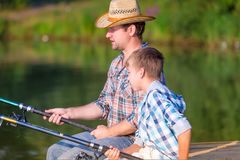 Boy and his father fishing togethe Royalty Free Stock Image