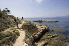 Boy with his father on a hiking trail in the cliffs. French riviera, mediterranean sea - adobe RGB Stock Photos
