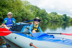 Boy with his father kayaking Royalty Free Stock Images