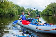 Boy with his father kayaking Royalty Free Stock Image