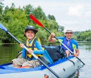 Boy with his father kayaking Royalty Free Stock Photos