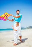 Boy and his father with kite Stock Photos