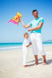 Boy and his father with kite Stock Images