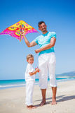 Boy and his father with kite Stock Photography