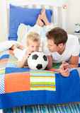 Boy and his father watching a football match Stock Photography