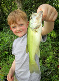 Boy with his first catch Royalty Free Stock Photos