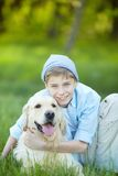 Boy and his friend Stock Photos