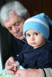 Boy and his grand father,portrait. Family in love stock photography