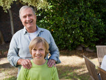 Boy with his Grandfather Stock Photos