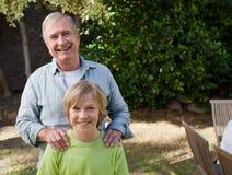 Boy with his Grandfather Stock Photos
