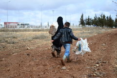 Boy with his grandmother illegaly entering into Turkey. They are leaving Syrian because of civil war Royalty Free Stock Photo