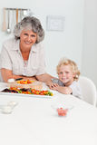 Boy and his grandmother looking at the camera Stock Images