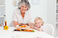 Boy and his grandmother looking at the camera Royalty Free Stock Photo