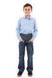 Boy with his hands in his pockets. Cute school boy with his hands in his pockets, isolated on white background Royalty Free Stock Photography