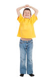 Boy with his hands up Stock Photo