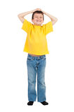 Boy with his hands up Stock Images