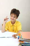 A boy and his homework Royalty Free Stock Photos