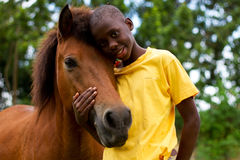 A boy and his horse. Boy showing affection to his horse Royalty Free Stock Photo