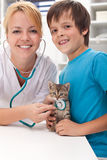 Boy and his kitten at the veterinary office Royalty Free Stock Photography