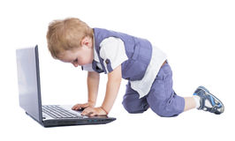 Boy at his laptop Stock Photography
