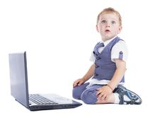 Boy at his laptop Royalty Free Stock Photography